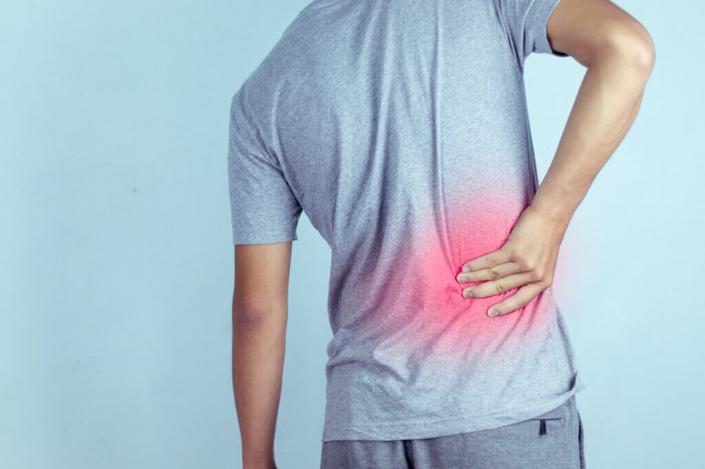 man suffering from backache,Lower back pain.